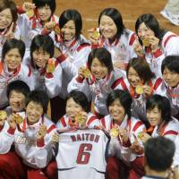 Members of the Japan team hold their gold medals after beating the United States in the final of the softball competition at the 2008  Beijing Olympics on Thursday. | KYODO PHOTOS