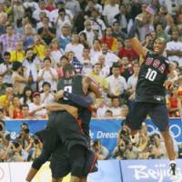 Redeemed: Kobe Bryant and the rest of Team USA celebrate their victory over Spain in the gold-medal match Sunday at the Beijing Olympics. The U.S. won 118-107 for its first gold medal in basketball since 2000. | KYODO PHOTO