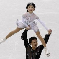 In prime position: Russia's Yuko Kawaguchi and Alexander Smirnov perform their short program during the pairs competition on Sunday. The pair were in third place heading into the free skate. | AP PHOTO