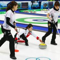 Rolling stone: Skip Moe Meguro leads her team down the ice during Japan's match against Russia in the Olympic curling competition on Sunday. Japan won 12-9 in 11 ends. | KYODO PHOTO