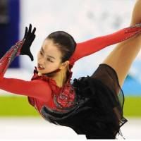 Second best: Mao Asada, performing in the free skate on Thursday, earns the silver medal behind rival Kim Yu Na of South Korea.   KYODO PHOTO