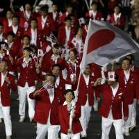 Moment of a lifetime:  Two-time Olympic wrestling gold medalist Saori Yoshida carries the Hinomaru at the Opening Ceremony of the London Games on Friday night.   AP
