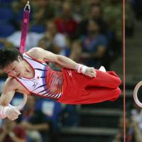 Get a grip: Japan's Kohei Uchimura competes in the Olympic gymnastics competition on Saturday in London.   KYODO