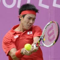 Nishikori edges Tomic in singles competition