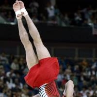 Kohei Uchimura performs the floor exercise during the men's gymnastics team competition at the London Games on Monday.