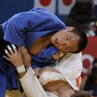 Over and out: Masashi Ebinuma sends Poland's Pawel Zagrodnik to the mat during their bronze-medal match on Sunday in London. Ebinuma won via ippon. | AP
