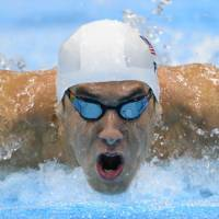 Closing in: Michael Phelps won the 17th medal of his Olympic career on Sunday, leaving him one short of the record held by Russian gymnast Larisa Latynina. | AFP-JIJI