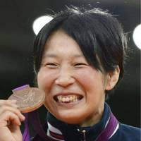 All smiles: Yoshie Ueno grabs the bronze medal in the  63-kg category of women's judo at the London Olympics on Tuesday. | KYODO