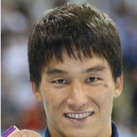 On the podium: Takeshi Matsuda takes the bronze in the men's 200-meter butterfly at the London Olympics on Tuesday. | KYODO