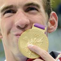 One for the ages: Michael Phelps became the most decorated Olympian ever after winning his 19th medal, a gold, in the men's 4x200 freestyle relay on Tuesday in London. Phelps tied the record, held by Soviet gymnast Larisa Latynina, by finishing between bronze medalist  Takeshi Matsuda (left) and winner Chad le Clos in the men's 200-meter butterfly earlier in the night. | AFP-JIJI
