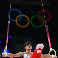 Golden form: Kohei Uchimura performs on the rings during the men's all-around final on Wednesday night. Uchimura won the gold medal with a score of 92.690 points. | AFP-JIJI