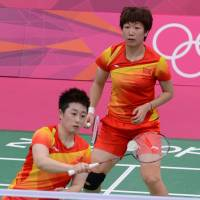 Shamed: China's Wang Xiaoli (right) and Yu Yang were kicked out of the London Games by Badminton World Federation officials on Wednesday for trying to lose a match.   AFP-JIJI