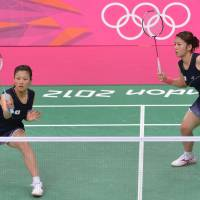 Going for gold: Reika Kakiiwa (left) and Mizuki Fujii compete in the doubles semfinal against Canada on Thursday at Wembley Arena. Japan won 21-12, 19-21, 21-13.   AFP-JIJI