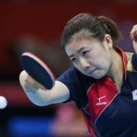 Steady as she goes: Japan's Ai Fukuhara returns a shot to Ariel Hsing of the U.S. during their women's table tennis team competition match at the London Games on Friday. | AP
