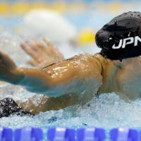 Team player: Japan's Yuka Kato swims the butterfly leg in the women's 4x100-meter medley relay heats at the Aquatics Centre on Friday. | AP
