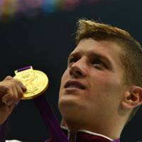 Never forget you: Daniel Gyurta, who won the 200-meter breaststroke final, plans to present a copy of his gold medal to the family of the late Alexander Dale Oen. | AFP-JIJI