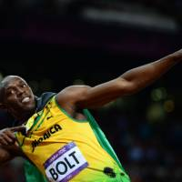 Reach for the stars: Usain Bolt celebrates after winning the men's 100 meters at the London Games on Sunday. | AFP-JIJI