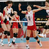 On the path again: Japan's women rejoice after beating China Tuesday in a 5-set victory, allowing them to advance to the semifinals for the first time since 1988. | KYODO PHOTO