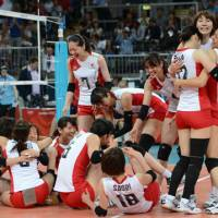 Exhausting battle: Japan's women's volleyball team celebrates after beating China in the Olympic quarterfinals on  Tuesday at Earls Court in London. Japan will compete in the semifinals for the first time since 1988. | AFP-JIJI