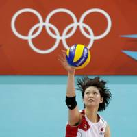 Brilliant victory: Saori Kimura serves against China in their quarterfinal match on Tuesday at Earls Court. Japan won 3-2 and will play Brazil in the semifinals on Thursday night. | AP