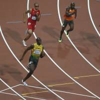 Bolt completes historic sweep with 200 victory