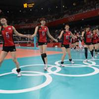Party time: Erika Araki (left) leads her Japan teammates in celebration after beating South Korea for the Olympic bronze volleyball medal on Saturday.   AFP-JIJI