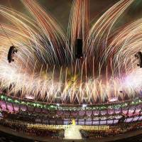 Going out with a bang: Japanese athletes enjoy the closing ceremony of the 2012 Games, which included a jaw-dropping fireworks show, at the Olympic Stadium in London on Sunday. | KYODO, AP