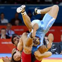Tatsuhiro Yonemitsu forces Sushil Kumar of India onto his back on his way to winning his 66-kg freestyle wrestling gold medal match Sunday.
