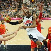 Kings of the court: U.S. guard Kobe Bryant attempts to score against Spain during the men's basketball final on Sunday in London. The U.S. won 107-100. | AFP-JIJI