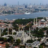 Full of history: Istanbul, the largest city in Turkey with 13.5 million people, is home to both the Blue Mosque (foreground) and the Hagia Sophia. It is a finalist to host the 2020 Olympic Games. | AP