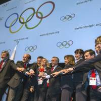 Long shot: Representatives of Madrid's bid for the 2020 Olympics celebrate in May after joining Tokyo and Istanbul as one of the three finalists to host the games. | AFP-JIJI