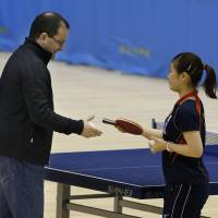 Fun and games: FIBA secretary-general Patrick Baumann, an IOC member, receives a racket from London Olympics table tennis silver medalist Ai Fukuhara before their friendly game at Tokyo Metropolitan Gymnasium on Tuesday. The visit was part of the IOC Evaluation Commission four-day inspection of Tokyo's bid to host the 2020 Olympics. | AP