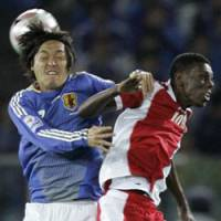 Deep impact: Yasuhito Endo (left) looked more comfortable in a deeper midfield role against Oman, helping to take some of the pressure off Japan manager Takeshi Okada. | AP PHOTO