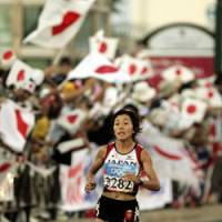Golden performance: Mizuki Noguchi, seen running in the women's marathon at the 2004 Athens Summer Olympics, is gearing up to defend her title next month in Beijing.   AP PHOTO