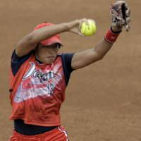 Superb performance: Yukiko Ueno pitched 28 innings over the last two days of the Olympic softball competition, leading Japan to its first-ever gold medal in the event. | AP PHOTO