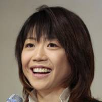 Fond farewell: Naoko Takahashi, the women's marathon champion in the 2000 Sydney Olympics, says she is retiring after competing for as long as she can as a professional. | AP PHOTO