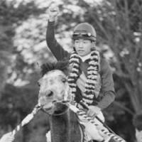 Memories: Oguri Cap and Yutaka Take pose for the cameras following their winning run in the 1990 Arima Memorial at Nakayama Racecourse in Chiba Prefecture. It was Oguri Cap's last run, a career-capping victory that clinched 'The Gray Monster' Horse of the Year status.   KYODO PHOTO