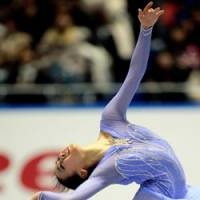 Elegance on ice: Mao Asada performs her short program at the NHK Trophy Grand Prix event on Friday at Yoyogi National Gymnasium. Asada leads the event heading into Saturday's free skate.   AP PHOTO