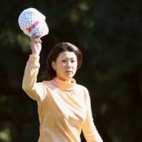 Career year: Miho Koga rallied from three strokes down to win the season-ending Tour Championship, enabling her to capture the money title for the first time in her career. | KYODO PHOTO