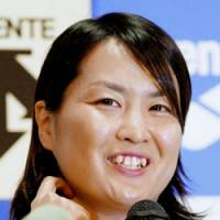 It's official: Swimmer Ai Shibata announces her retirement during a news conference on Thursday. The 26-year-old captured the gold medal in the women's 800-meter freestyle at the 2004 Athens Games. | KYODO PHOTO