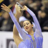Beauty on ice: Mao Asada performs during the women's short program of the Grand Prix Final on Friday at Goyang, South Korea. Asada placed second. | KYODO PHOTO