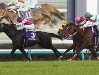 Close finish: Seiun Wonder edges hard-charging Fifth Petal to claim the winner's trophy in the Asahi Cup Futurity Stakes on Sunday. | KYODO PHOTO