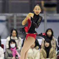 Comeback queen: Mao Asada won three major competitions last year despite trailing after the short program. | KYODO PHOTO