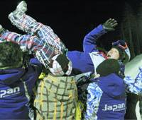 Teammates toss Yugo Tsukita aloft after the freestyle skier takes second place in the men's moguls at a World Cup event.   KYODO PHOTO