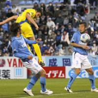 Pale imitation: Former J. League powerhouse Jubilo Iwata (in blue) has looked a shadow of its former self in recent years. | KYODO PHOTO