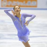 In position: Mao Asada performs during the short program of the women's event at the World Team Trophy at Tokyo's Yoyogi National Gymnasium on Thursday night. | KYODO PHOTO