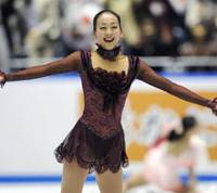 Crowd-pleasing performer: Mao Asada delights the crowd at Tokyo's Yoyogi National Gymnasium on Saturday, winning the women's program in the World Team Trophy. Mao earned 201.87 points to help Japan place third in the inaugural six-nation tournament.   KYODO PHOTO