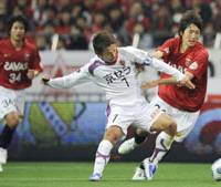 New blood: Genki Haraguchi (right) and Naoki Yamada (left) have helped Urawa Reds reach the top of the J. League table. | KYODO PHOTO