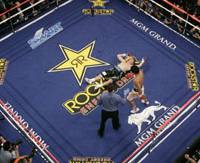 Boxing's new star: Manny Pacqiuao walks past the prone figure of Ricky Hatton after knocking out the British fighter in the second round of their fight on Saturday in Las Vegas. | AP PHOTO