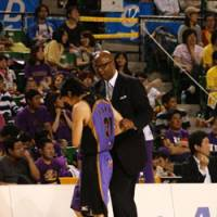 Strong mentor: Tokyo Apache coach Joe Bryant, in his fourth season at the helm, takes pride in helping the team's Japanese players, including Masashi Joho (pictured) raise their level of play. | KAZ NAGATSUKA